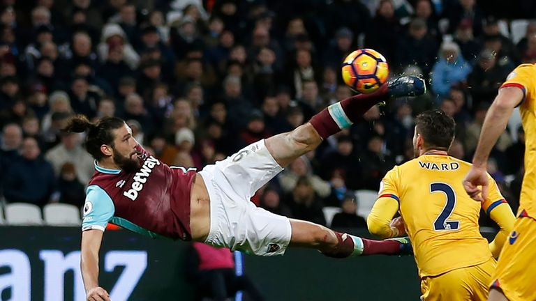 Andy Carroll shoots to score with this bicycle kick