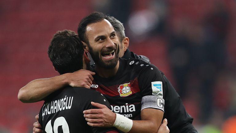 Hakan Calhanoglu celebrates scoring for Bayer Leverkusen