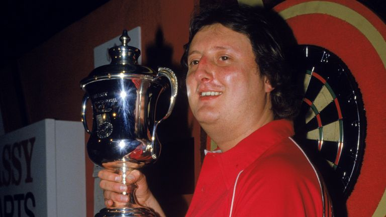 Eric Bristow shows off his 1986 World Championship trophy that earned him a third successive title