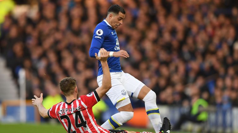 Jack Stephens of Southampton (L) tackles Ramiro Funes Mori of Everton