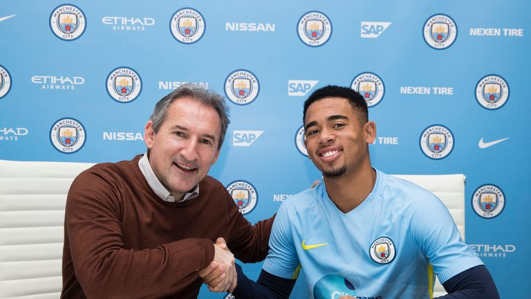 Manchester City chief Txiki Begiristain shakes hands with new signing Jesus