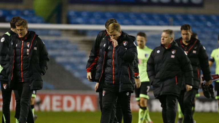 Bournemouth manager Eddie Howe (C) leaves dejected after his side's FA Cup exit