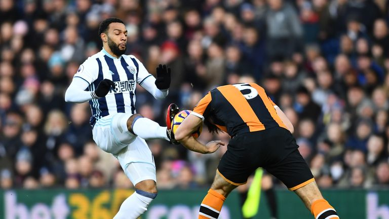 Matt Phillips of West Brom challenges Hull's Harry Maguire
