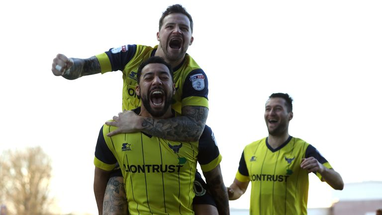 Kane Hemmings (bottom) of Oxford United celebrates scoring the opening goal against Newcastle with his team mate Chris Maguire