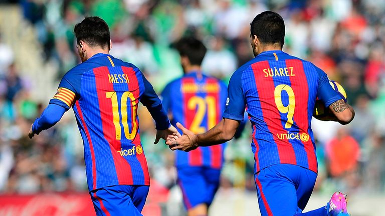 Lionel Messi (L) and Luis Suarez celebrate Barca's late equaliser at Real Betis