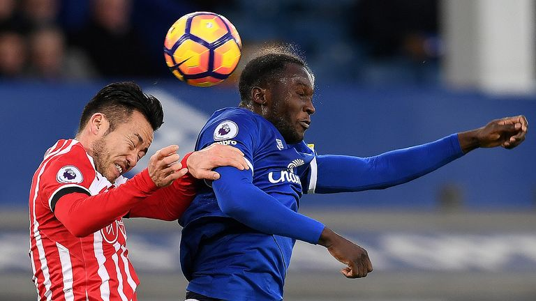 Maya Yoshida and Romelu Lukaku compete for a header at Goodison Park