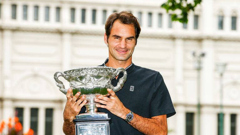Roger Federer poses with the Norman Brookes Challenge Cup after winning the 2017 Australian Open