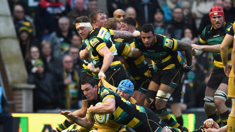 Louis Picamoles dives over the line to score Northampton's first try