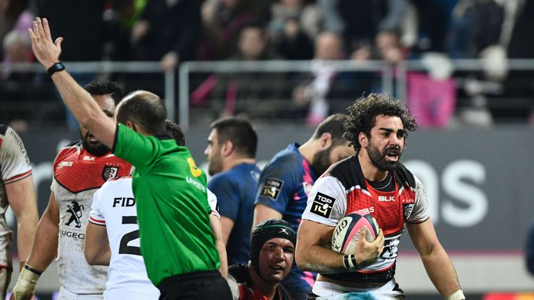 Yoann Huget (right) celebrates after scoring one of his two late tries against Stade Francais