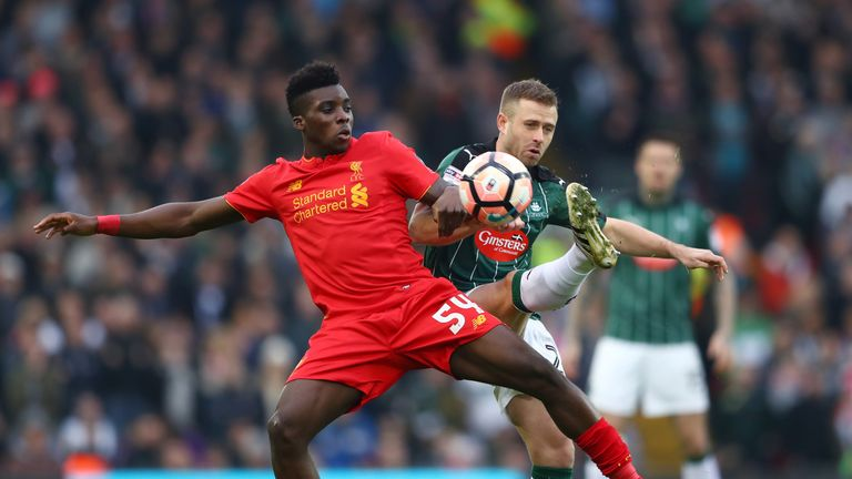 Liverpool's Sheyi Ojo battles for possession with David Fox.