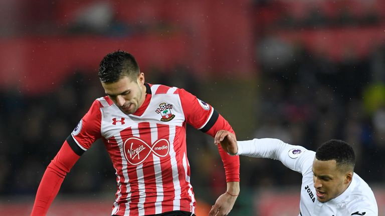 Dusan Tadic (left) of Southampton and Martin Olsson of Swansea City compete for the ball