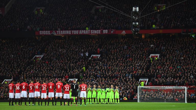 During a pre-match tribute to former England manager Graham Taylor, Spidercam hangs over the Old Trafford pitch - its first use in a Premier League game