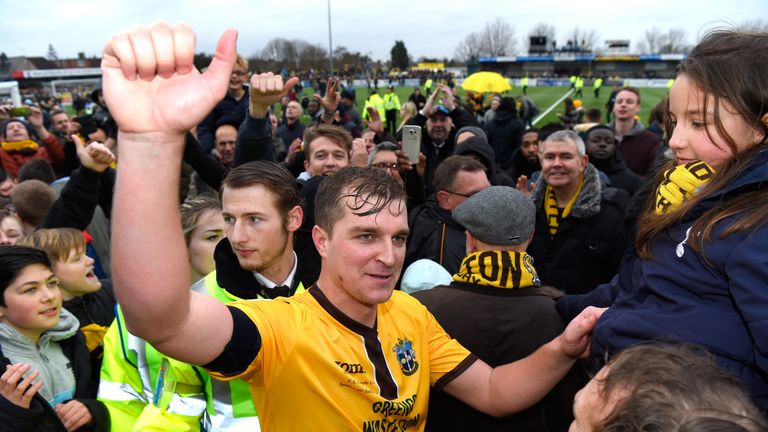 Jamie Collins is mobbed by Sutton United fans after the FA Cup win over Leeds