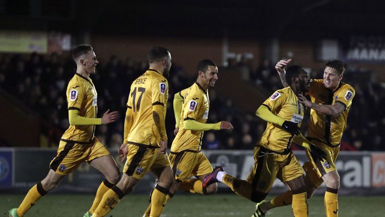 Sutton United's Roarie Deacon (2nd R) equalised for the visitors