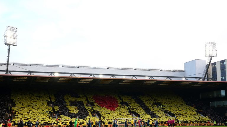 Watford fans create a display with cards as they pay tribute to former manager Graham Taylor