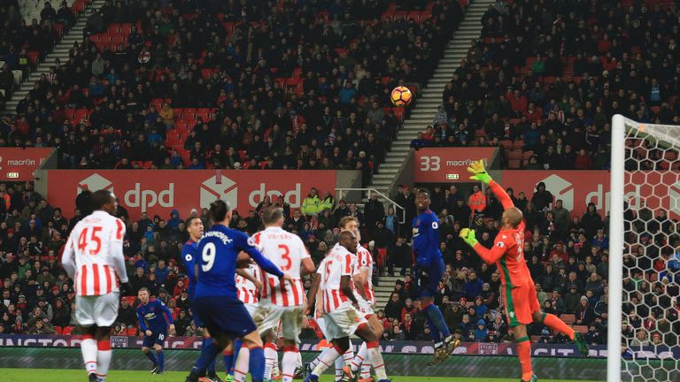 Rooney curls home a late free-kick to break Stoke hearts