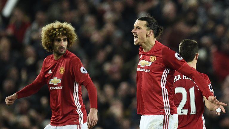 Manchester United's Swedish striker Zlatan Ibrahimovic (C) celebrates his equaliser against Liverpool