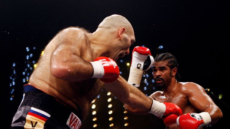 Haye (R) beat Nikolai Valuev for the WBA title under Booth's supervision