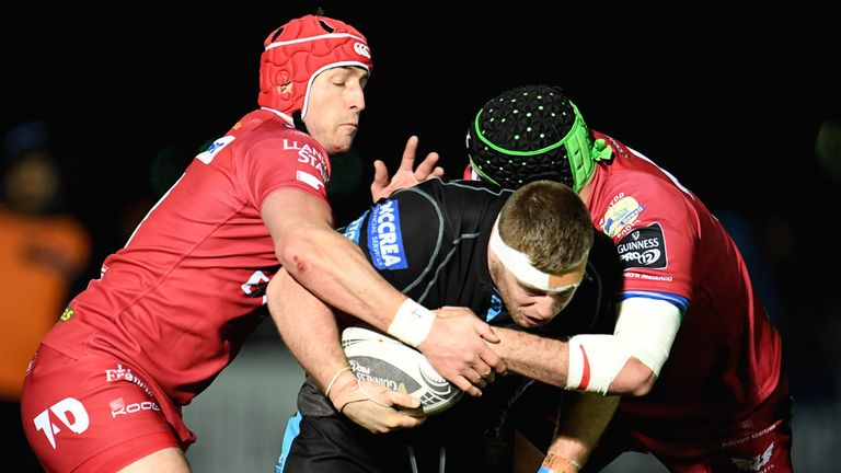 Glasgow prop Alex Allan in closed down by the Scarlets defence