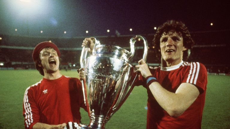 Aston Villa's Tony Morley (left) and Allan Evans (right) lift the European Cup after beating Bayern Munich