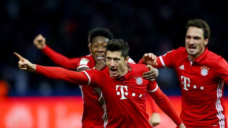 Robert Lewandowski scored twice to help Bayern Munich beat Eintracht Frankfurt 3-0