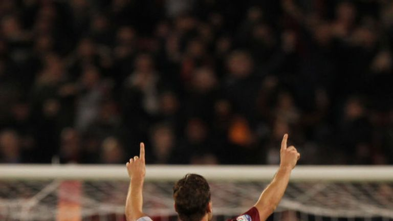 Francesco Totti celebrates after scoring the winner for Roma