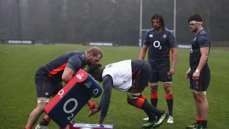 Maro Itoje charges into the tackle bag held by James Haskell as Tom Wood and Jack Clifford (right) look on