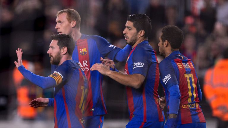 Barcelona forward Lionel Messi (L) is congratulated after scoring his side's winner against Leganes