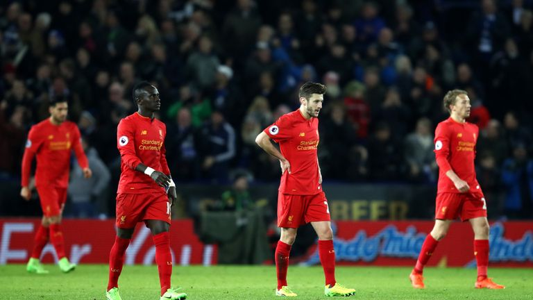 Liverpool players look dejected after their defeat at Leicester