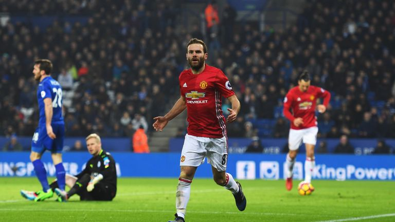 Juan Mata celebrates as he scores United's third goal