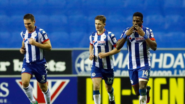 Wigan Athletic's Omar Bogle (right) celebrates after opening his account
