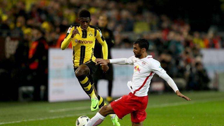 Borussia Dortmund's Ousmane Dembele skips past an RB Leipzig challenge