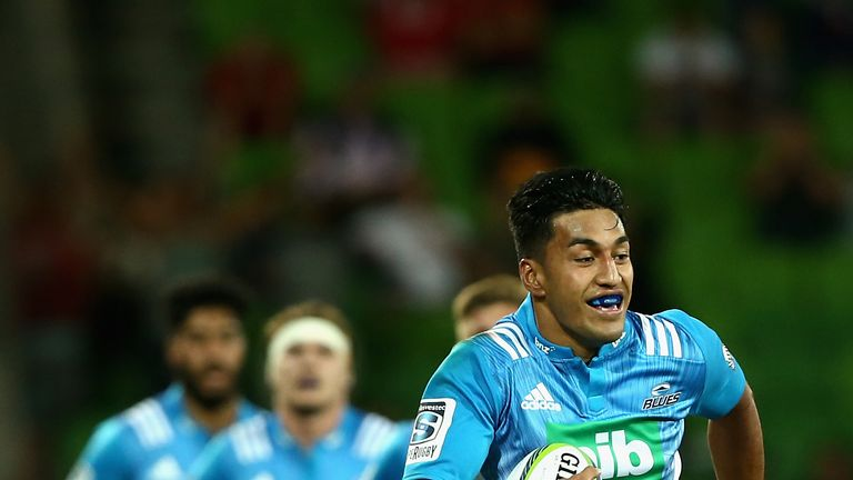 Rieko Ioane runs in a try for the Blues
