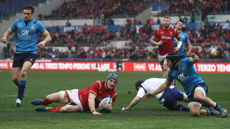 Jonathan Davies slides over to score Wales' first try against Italy