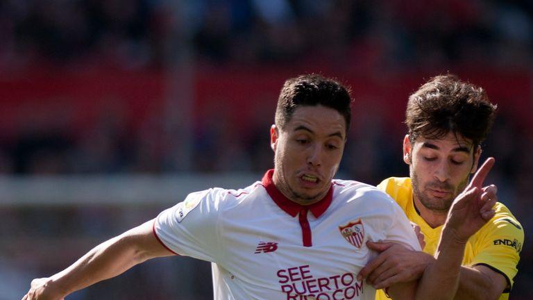Nasri (left) in action for Sevilla