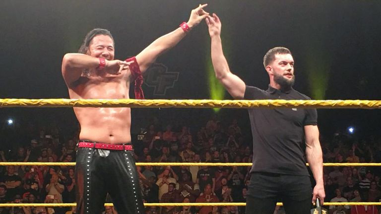 Finn Balor (right) attacked Andrade Almas and Bobby Roode on Wednesday night