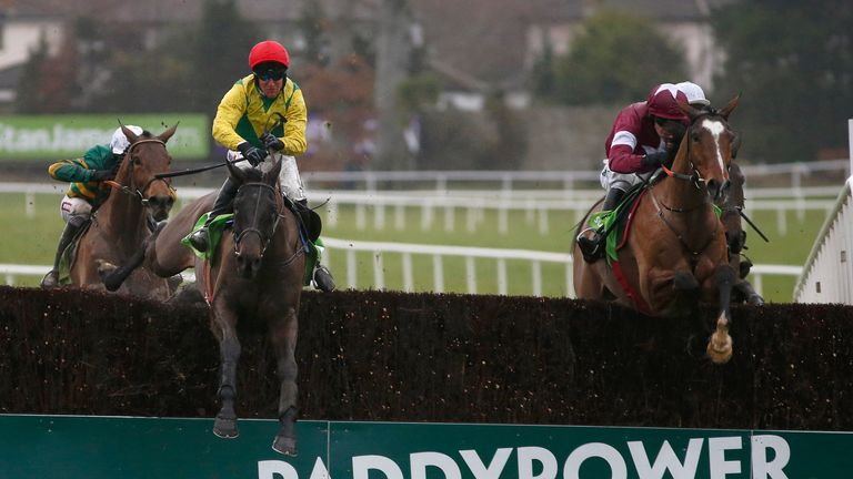 Robbie Power riding Sizing John (red cap) clear the last ahead of Don Poli in the Irish Gold Cup at Leopardstown