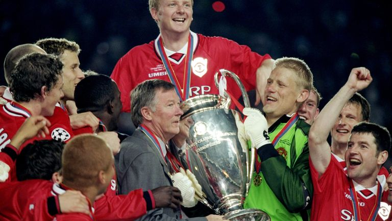 Manchester United manager Alex Ferguson and keeper Peter Schmeichel with the trophy after a 2-1 victory over Bayern Munich in 1999