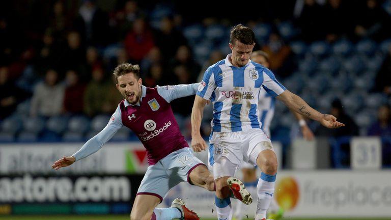 Aston Villa's James Bree tackles Huddersfield Town's Jonathan Hogg