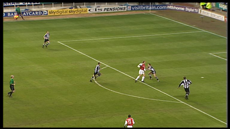 Bergkamp flicks the ball around Newcastle's Nikos Dabizas