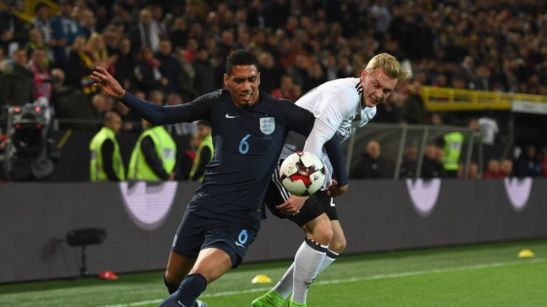 Chris Smalling (left) played against Germany but will be unavailable this weekend