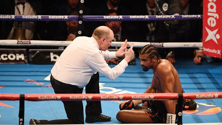 The referee counts over David Haye after he was knocked to the canvas by  Tony Bellew in their first fight