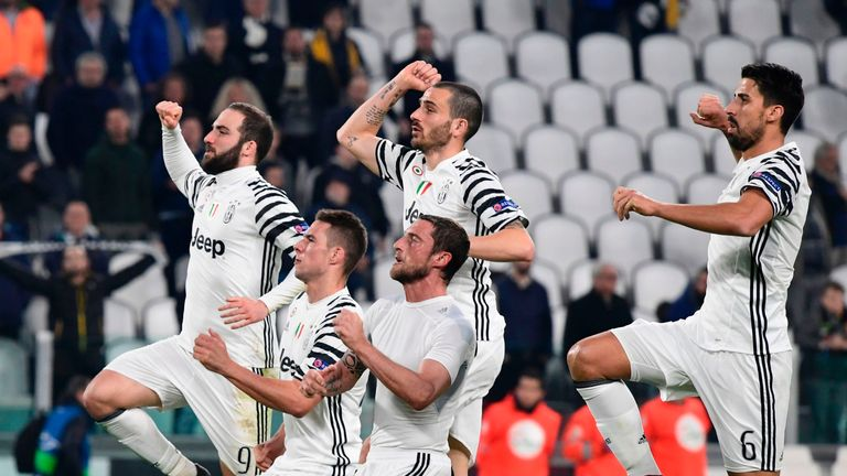 Juventus players celebrate with supporters
