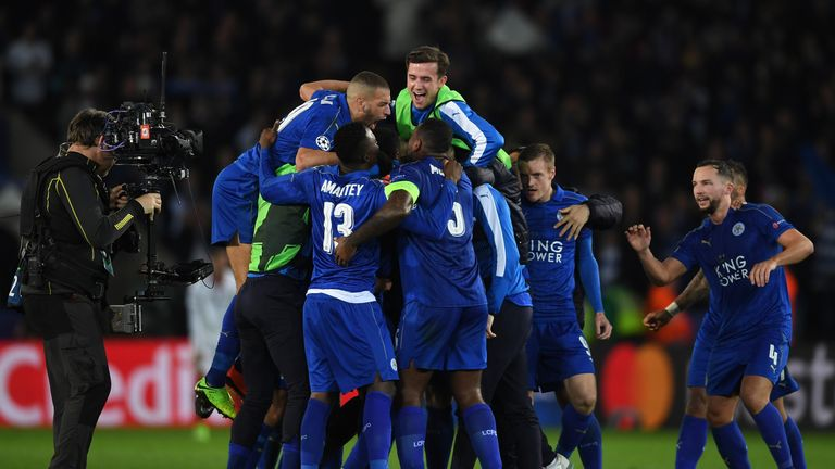 Leicester celebrate reaching the Champions League quarter-finals for the first time