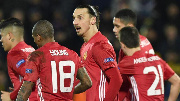 Man Utd's players celebrate opening the scoring at the Olimp-2 stadium