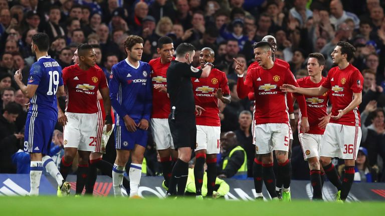 United players protest as Ander Herrera (right) is shown a red card