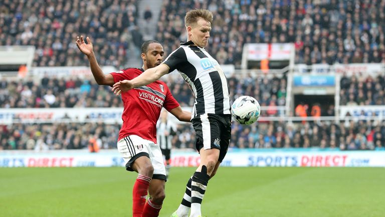 Matt Ritchie (right) and Fulham's Dennis Odoi tussle