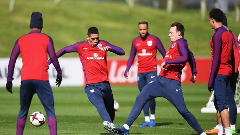 Chris Smalling tackles Manchester United team-mate Phil Jones in England training