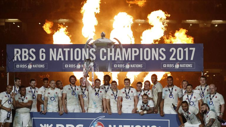 England players celebrate with the Six Nations trophy after despite the loss to Ireland