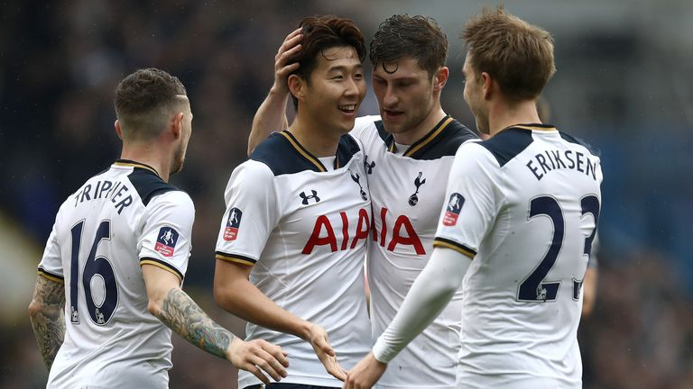 Son is congratulated by his Spurs team-mates after his long-range strike put his side 2-0 up against Millwall